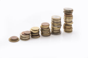 Rising stacks of euro coins isolated on white, interest and grow