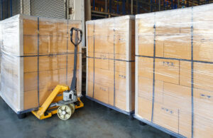 Stack cardboard boxes wrapping plastic on pallets and hand palle